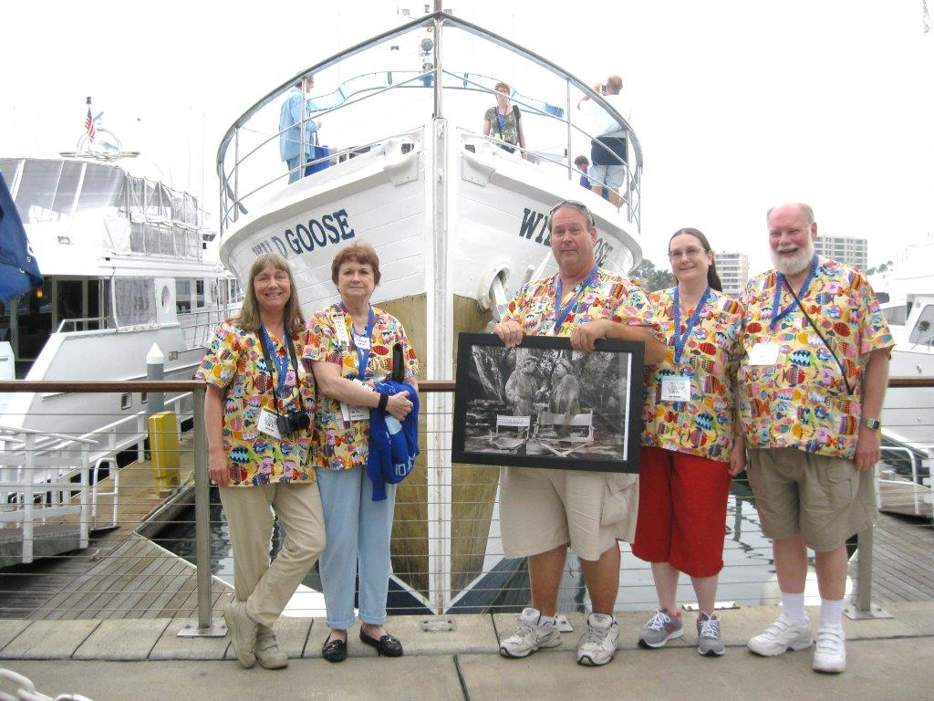 Marcia Opal, Lori Jones McCaffery, me Bob Satterfield, Dee & Lee McBeath show off our matching scrubs with fishes on them and a picture of John Wayne and Oliver Hardy in front of the Wild Goose.