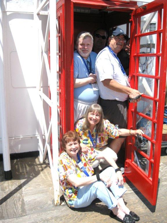 "Marcia's traditional ""load the telephone booth"" photo (which is getting harder to do since there are so few telephone booths)."