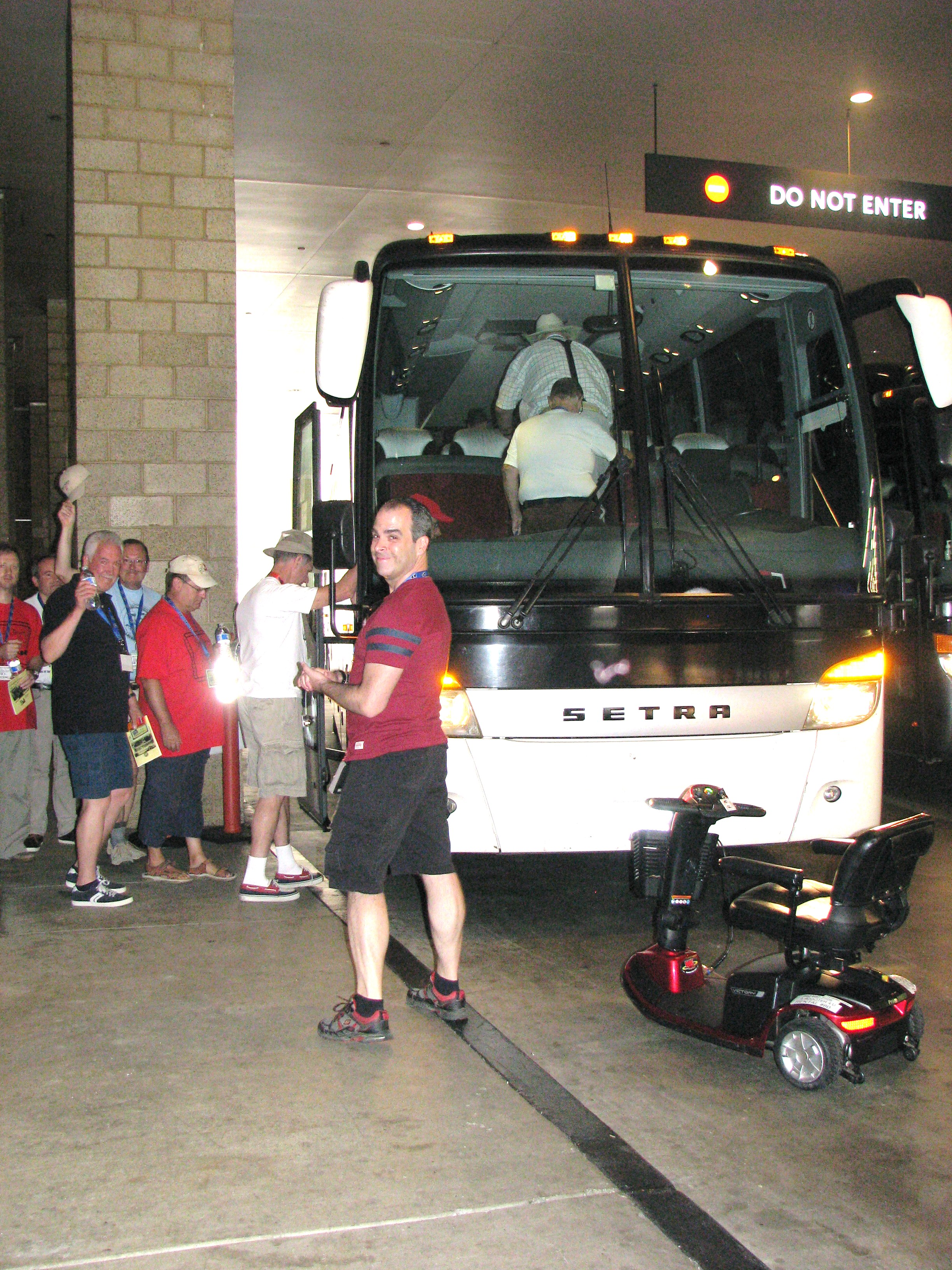 David Rodriguez oversees the boarding of the large coaches.