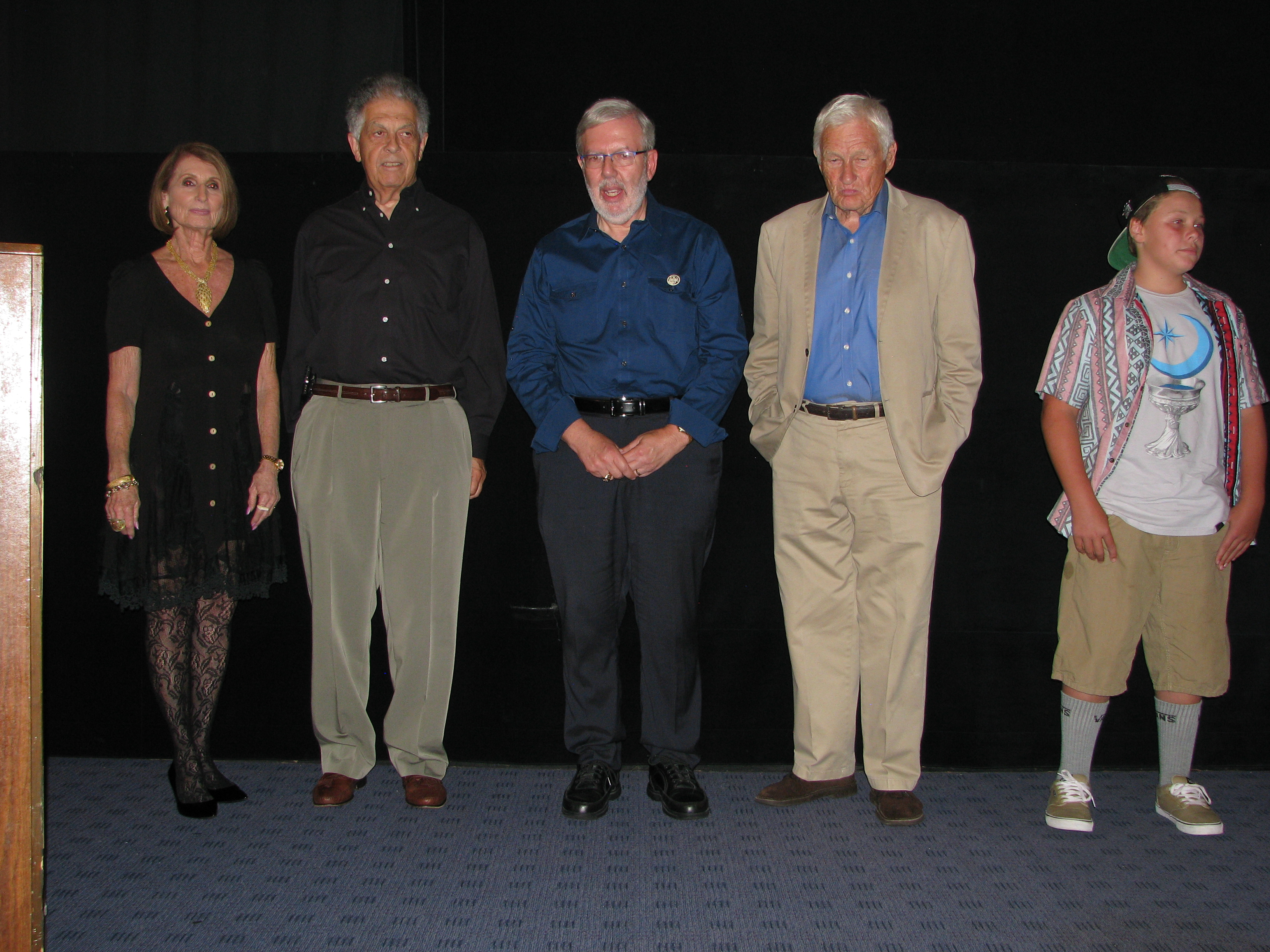 The givers of the toasts pose on stage before taking their seats (Joan, Ralph, film historian Leonard Maltin and Tommy)