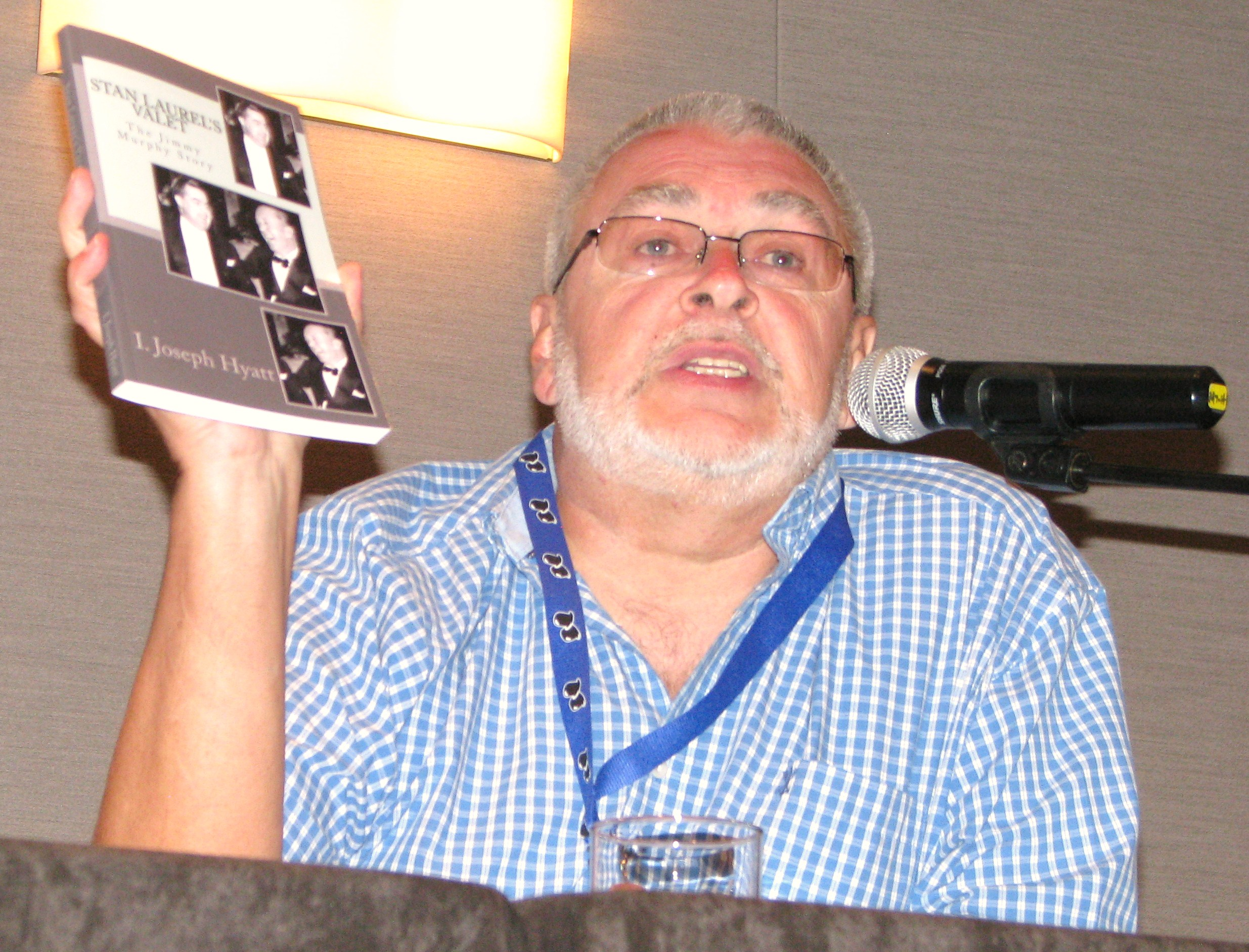 Irv Hyatt shows off one of his books.